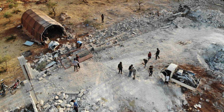Image: An aerial view of the site that was hit by helicopter gunfire which reportedly killed nine people near the northwestern Syrian village of Barisha in the Idlib province along the border with Turkey