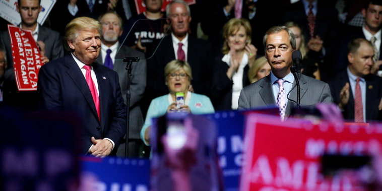 Image: Republican presidential nominee Donald Trump watches as British pro-Brexit politician Nigel Farage speaks at a campaign rally in Jackson, Mississippi