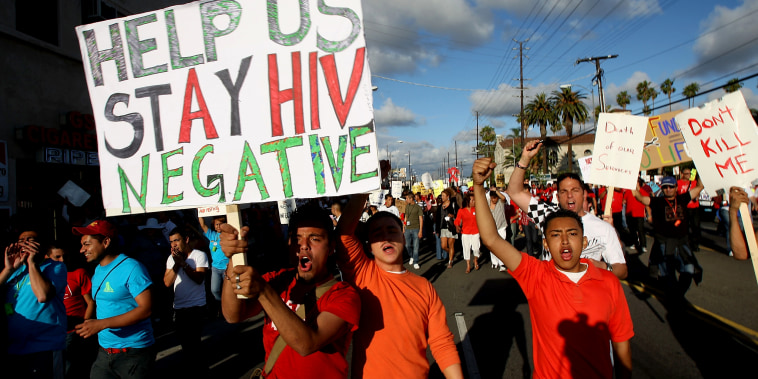 Image: Supporters and AIDS patients march to protests budget cuts to life-saving AIDS services in California on June 5, 2009.
