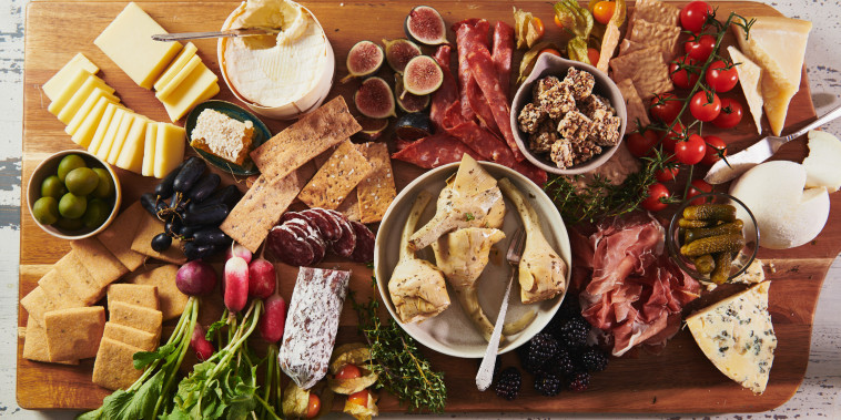 A graze board of meat, cheese, fruit, vegetables and other snacky things