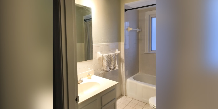 See this bathroom get totally transformed with shiplap and peel and stick tiles