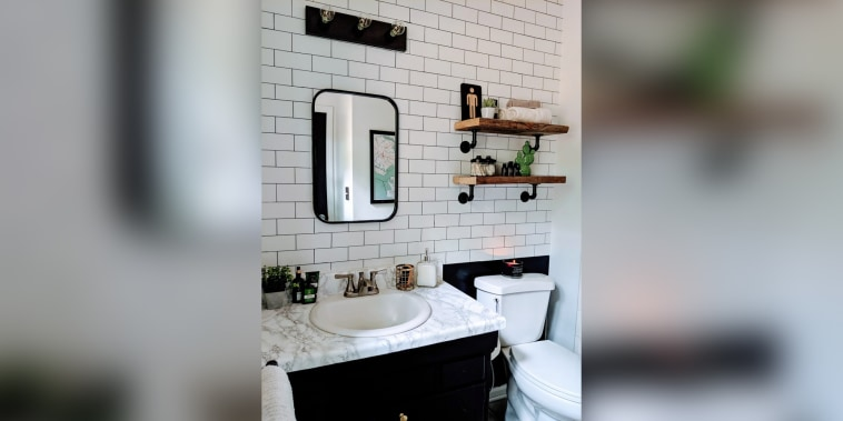 This bathroom's wall of white subway tile only cost $3