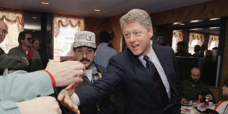 Democratic presidential hopeful Bill Clinton reaches for support while on a campaign stop in Manchester, N.H., on Feb. 13, 1992.