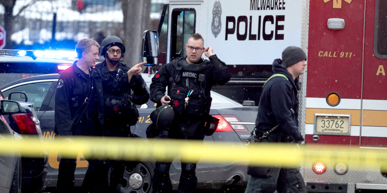 Image: Police and emergency officials work at an active shooter scene at the Molson Coors headquarters in Milwaukee