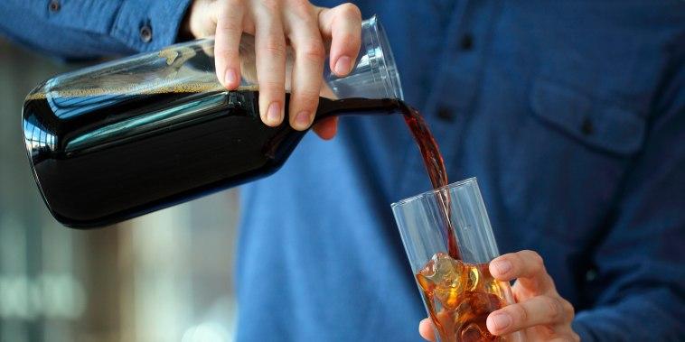 Barista making iced coffee, Kenwood, California, USA