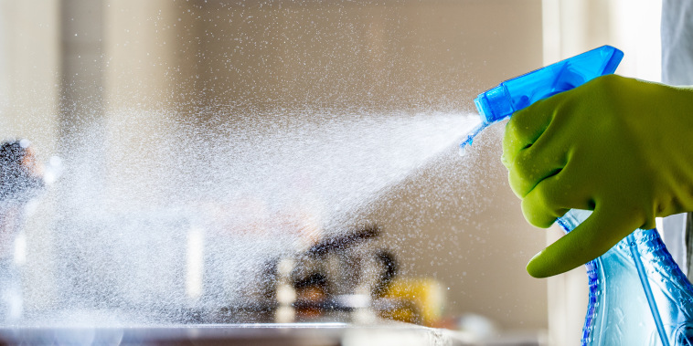 Spraying Cleaning Product on the Kitchen Counter