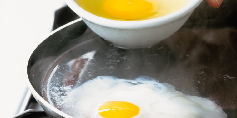 Eggs being poached in frying pan