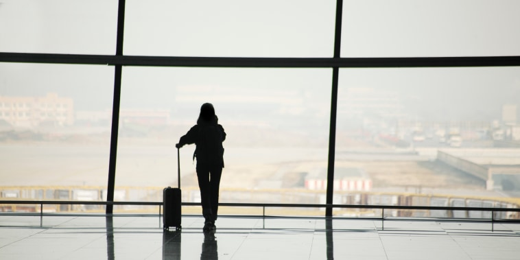 Silhouette of travelers in airport