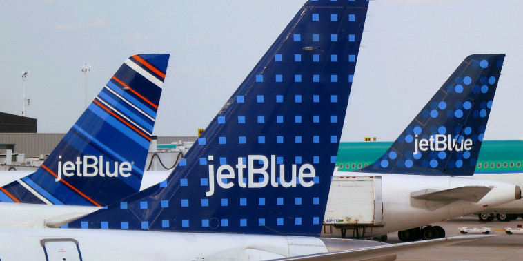 Image: JetBlue Airways aircrafts are pictured at departure gates at John F. Kennedy International Airport in New York.