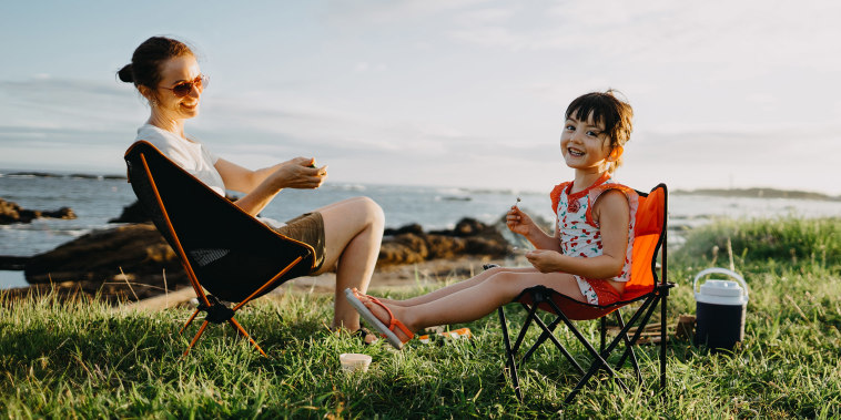 Mother and child enjoying camping by the sea