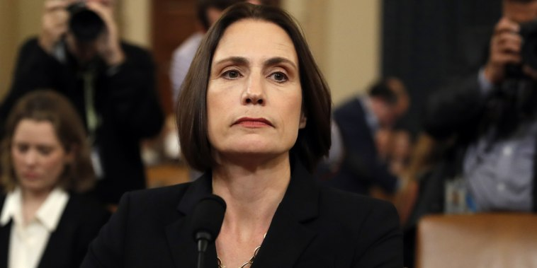 Former White House national security aide Fiona Hill returns from a break to testify before the House Intelligence Committee on Capitol Hill on Nov. 21, 2019.