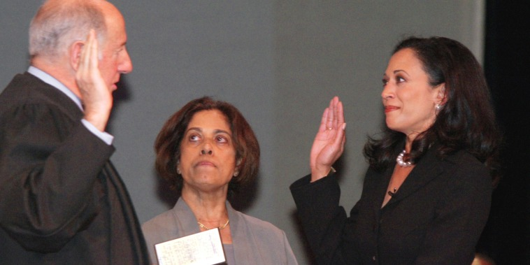 Image: San Francisco's new district attorney, Kamala Harris, right, receives the oath of office