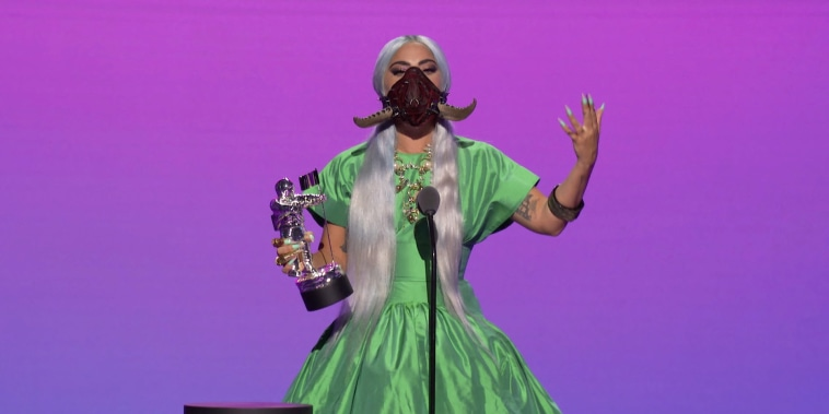 Image: Lady Gaga accepts the award for Artist of the Year during the 2020 MTV VMAs