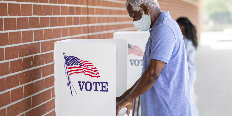 Senior Black Man Voting with a Mask