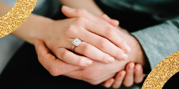 Photo of Hands accepting Proposal
