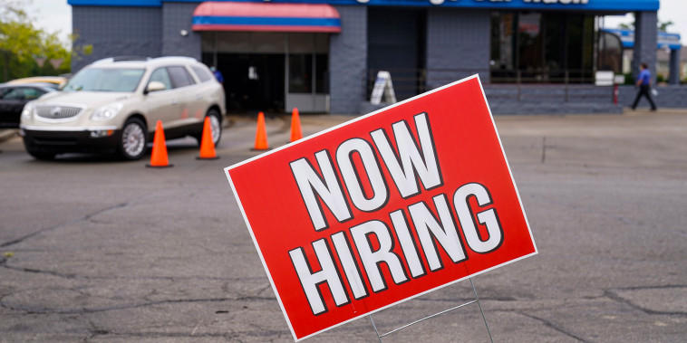 Image: A help wanted sign is displayed at car wash in Indianapolis
