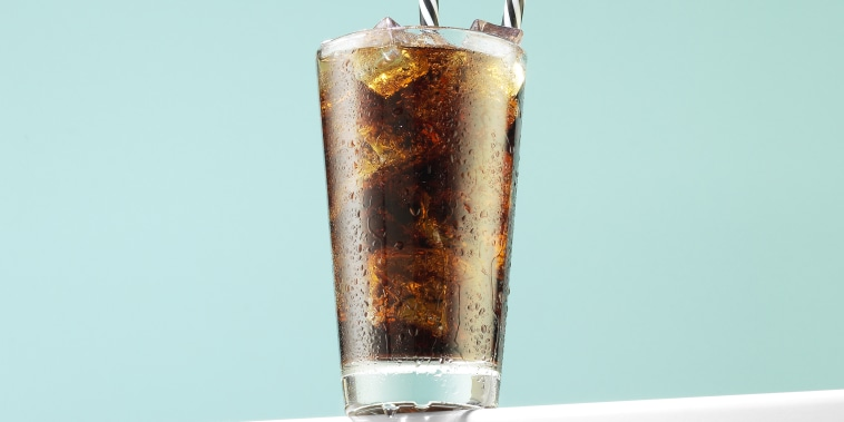 Soda Drink with Ice Cubes and Reusable Drinking Straws