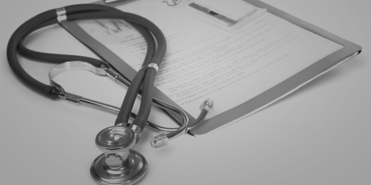 Stethoscope and a report isolated over white