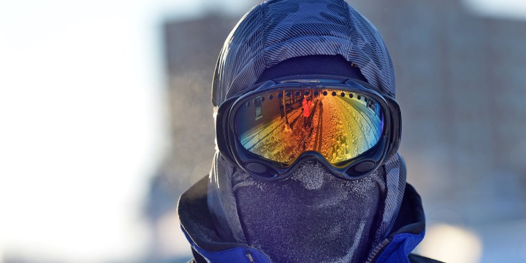 Image: Chris Griesmeyer dons ski goggles and a mask to protect him from the harsh wind chill