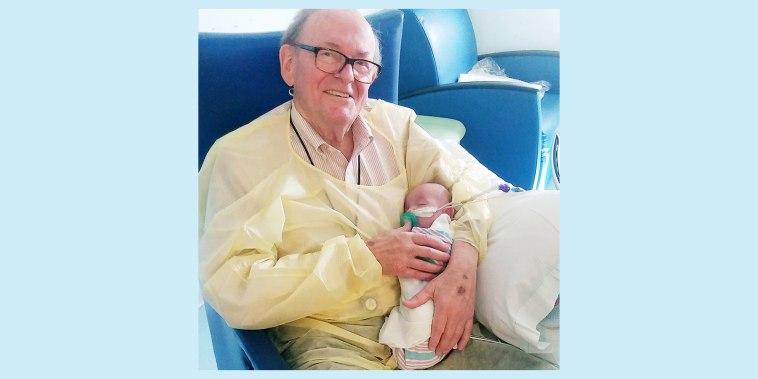 David Deutchman, 82, holds Logan Brulotte, 5 months