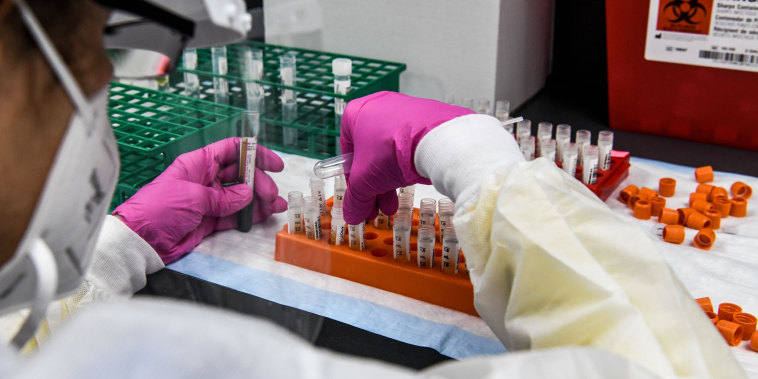 A lab technician sorts blood samples inside a lab for a Covid-19 vaccine study at the Research Centers of America (RCA) in Hollywood, Florida.