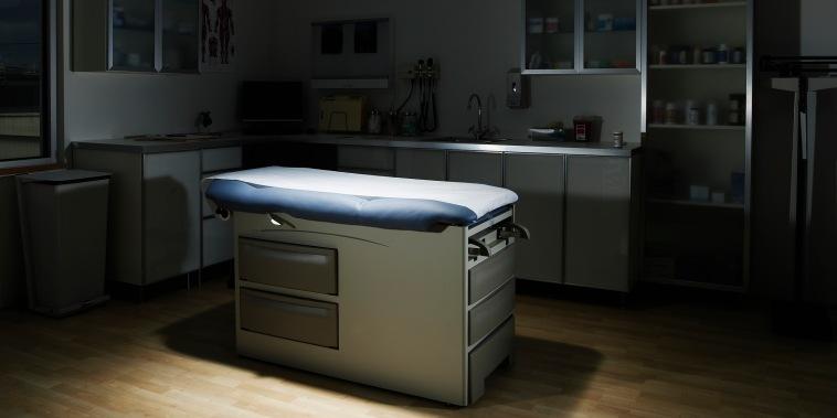 Empty examination room with spotlight