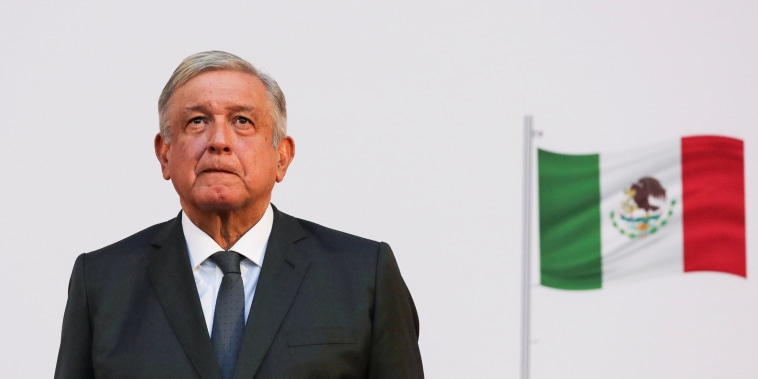 Image: Mexico's President Andres Manuel Lopez Obrador listens to the national anthem after addressing the nation on his second anniversary as the President of Mexico, at the National Palace in Mexico City