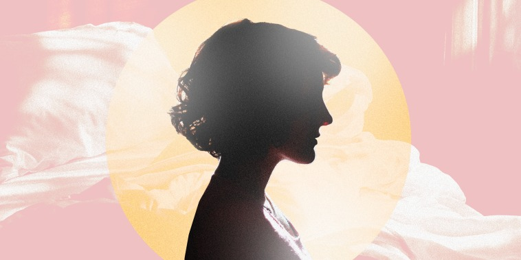 Image: A silhouette of a woman in a yellow sun with an empty, sun drenched bed behind her.