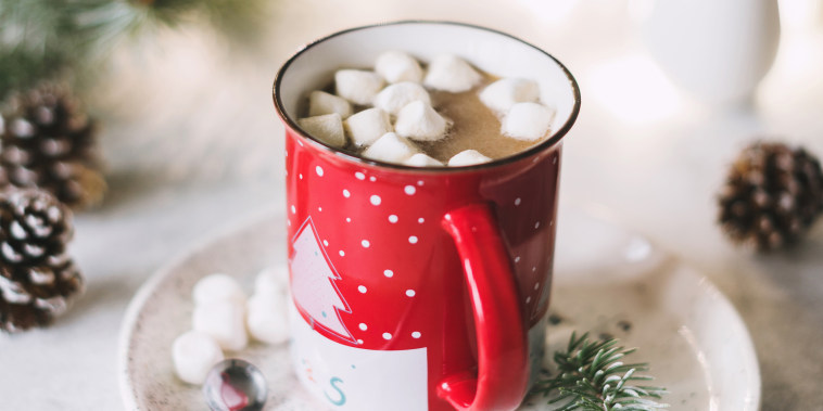 Hot cocoa with marshmallows in red Christmas cup SQUARE