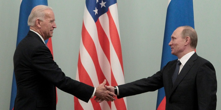 Image: Russian Prime Minister Vladimir Putin shakes hands with Vice President Joe Biden during their meeting in Moscow