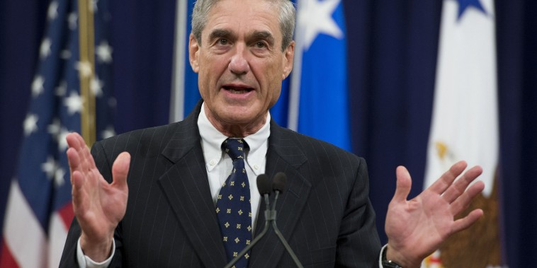 Image: Robert Mueller speaks during a farewell ceremony in his honor at the Department of Justice