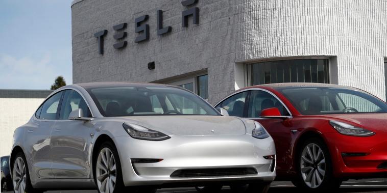 Image: Model 3 Long Range vehicles sit on a Tesla dealer's lot in the south Denver suburb of Littleton, Colo.