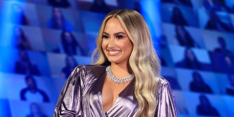 In this image released on November 15, Demi Lovato speaks onstage for the 2020 E! People's Choice Awards held at the Barker Hangar in Santa Monica, California.