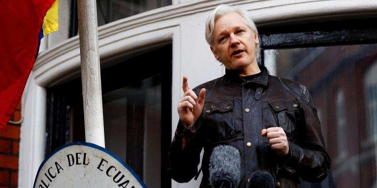 Image:  WikiLeaks founder Julian Assange speaks on the balcony of the Ecuadorian Embassy in London