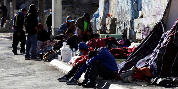 Image: Migrants rest in an improvised shelter set up outside the Posada Belen migrant shelter, which is closed due to an outbreak of the coronavirus disease COVID-19, in Saltillo