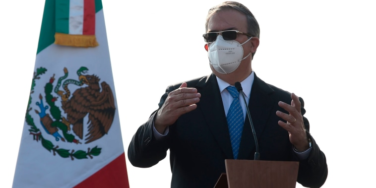 Image: Mexican Foreign Minister Marcelo Ebrard speaks during a ceremony to mark the arrival of doses of the first batch of Pfizer vaccines, Benito Juarez International Airport in Mexico City