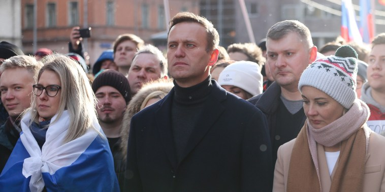 Image: Alexey Navalny, Russian opposition leader, center, and his wife Yulia, right, walk with demonstrators during a rally in Moscow.