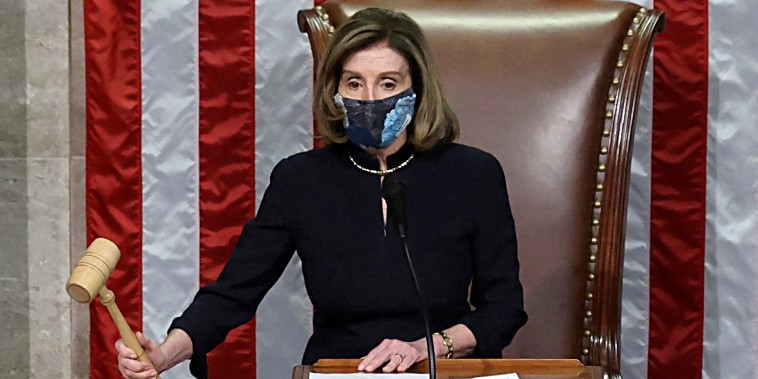 Image: House Speaker Nancy Pelosi presides over the vote to impeach President Donald Trump