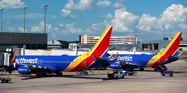 Southwest Airlines jets sit at gates at Love Field in Dallas