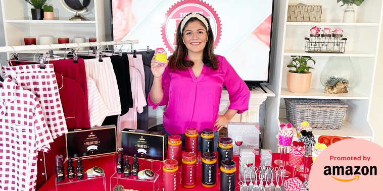 Adrianna Brach with some products in front of her