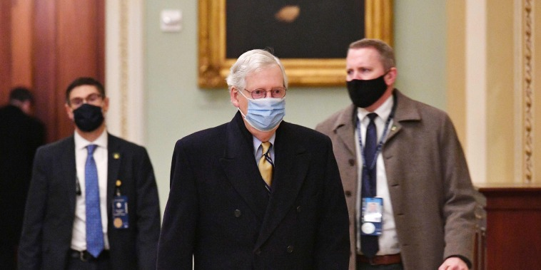 Senate Minority Leader Mitch McConnell arrives at the Capitol on Feb. 13, 2021.