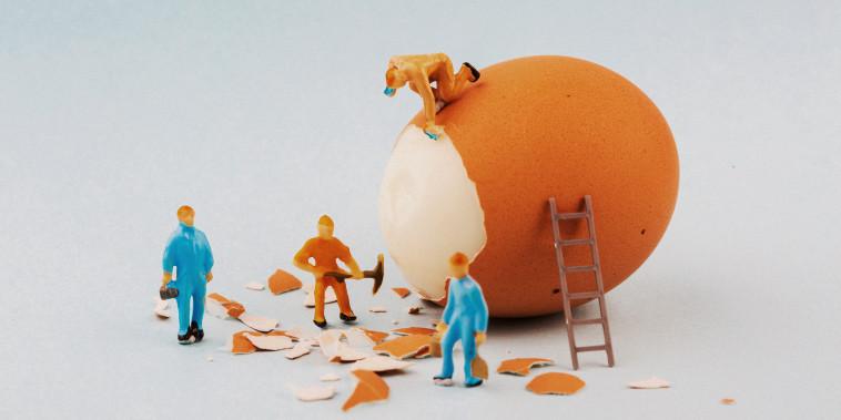 Peeling off the hard egg shell. Figurines work hard