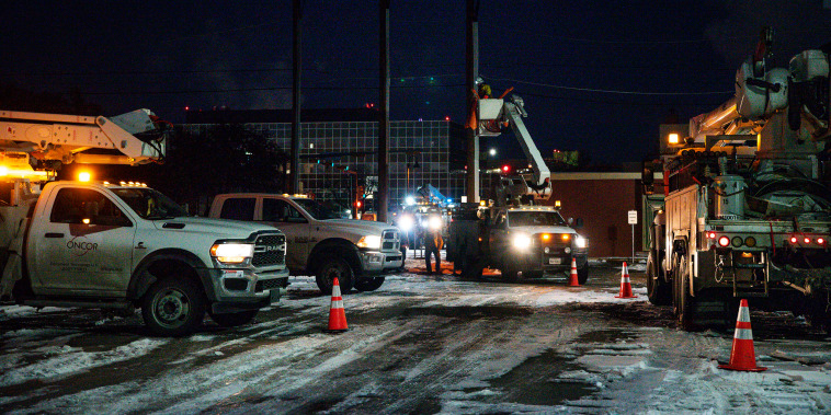 Image: An Oncor Electric Delivery lineman crew works on repairing a utility pole