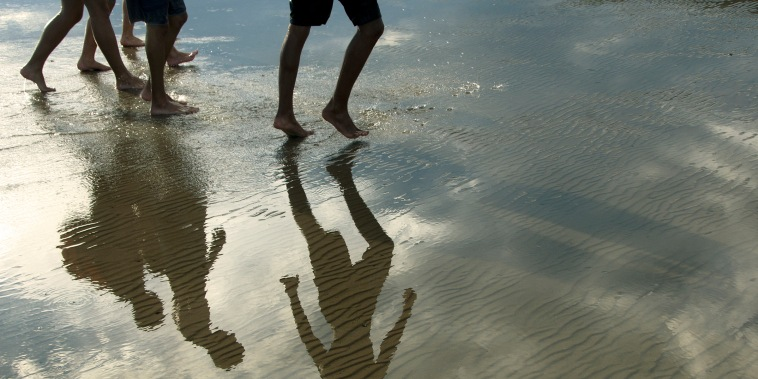 Teenagers walking on the beach