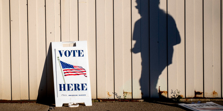 Image: A voter walks toward the entrance of the Boys and Girls Clubs of the Great Lakes Bay Region to cast their ballot in Bay City, Mich., during Election Day on Nov. 3, 2020.