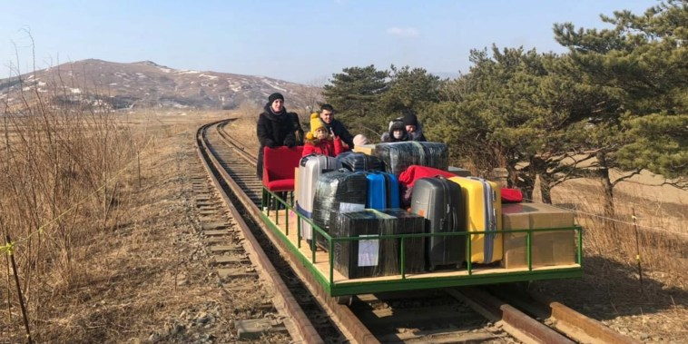 Image: Russian diplomats and family members leave North Korea to Russia using a hand-pushed rail trolley due to Pyongyang's coronavirus restrictions