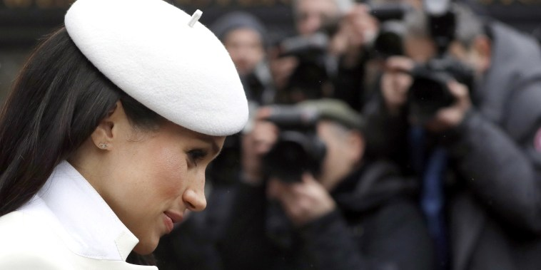 Image: Photographers focus on Meghan Markle, fiancee of Britain's Prince Harry as she leaves a Commonwealth Day Service at Westminster Abbey in central London