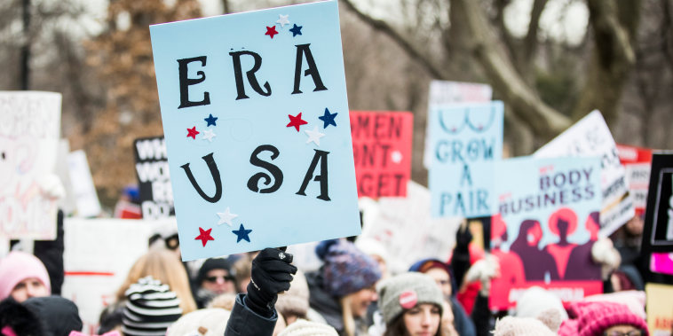 """A marcher holds a sign that say, \""""ERA USA\"""" during the Woman's March in New York City on Jan. 18, 2020."""