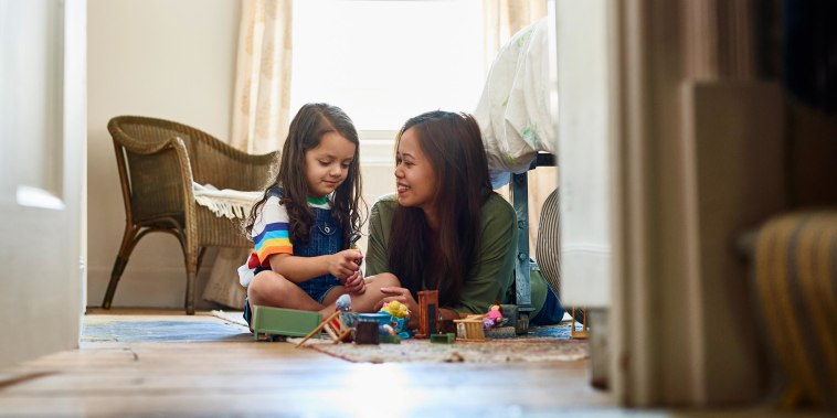 Mother and daughter playing with toys
