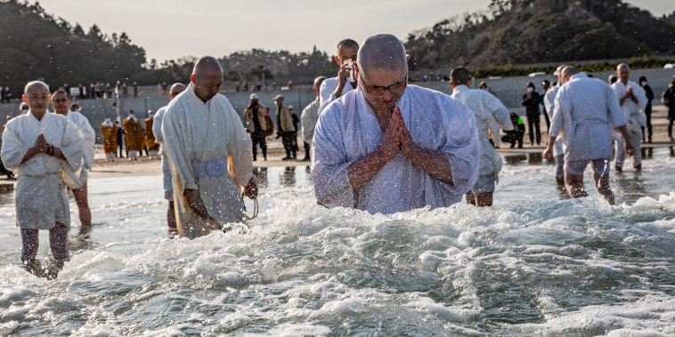 Image: Buddhist monks pray for the victims of the 2011 Tohoku earthquake and tsunami at a beach in Iwaki, Japan.